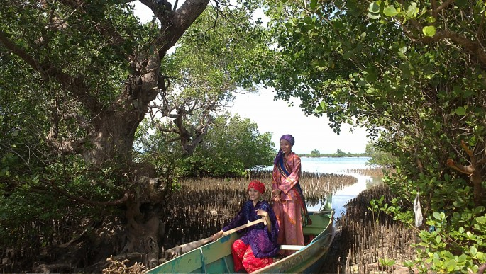 women returning home from fishing