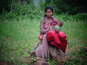 kodhu woman feeding her child