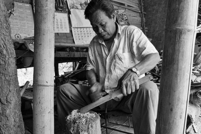 lahu basket weaver shaving the bamboo